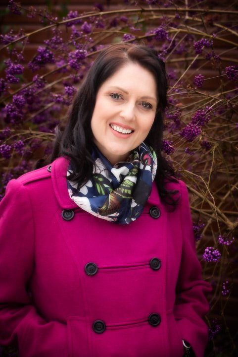 colourful outdoor photo of local business lady wearing a cerise coloured coat