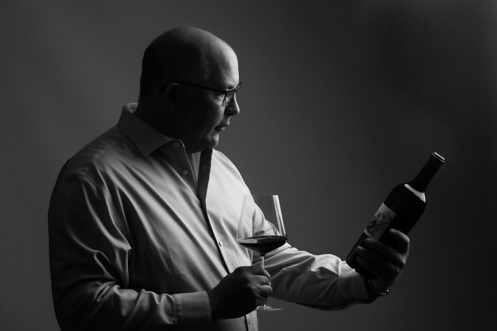 wine importer with a bottle of wine